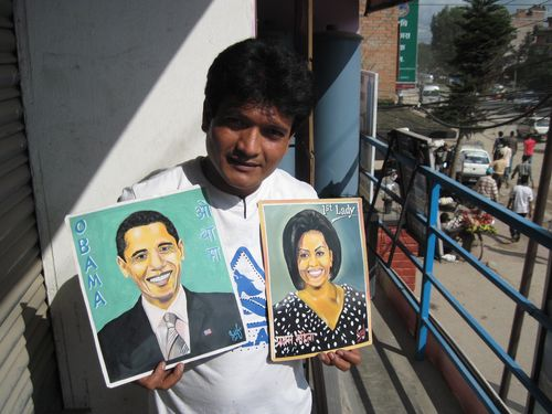 Sufraj with his folk art Obamas