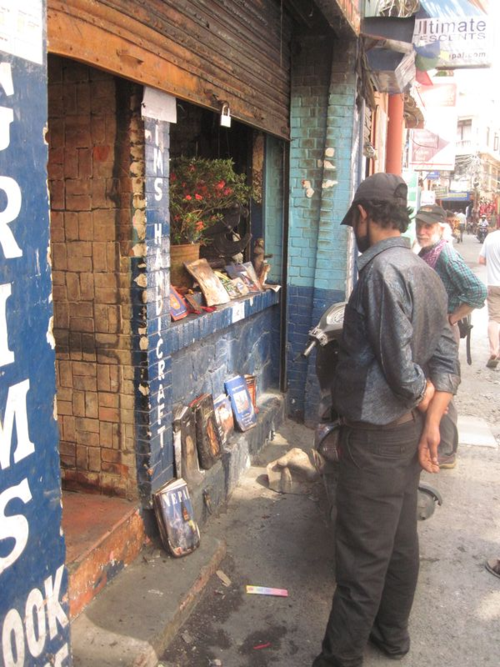 Burnt books make a shrine in front of Pilgrims Bookstore