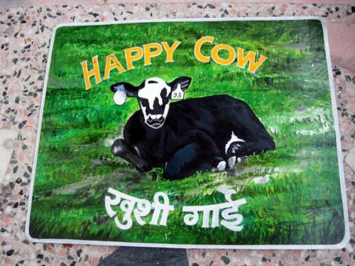 Folk art Cow hand painted on metal