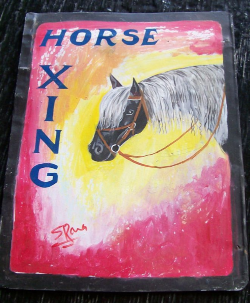 Folk art horse hand painted on metal