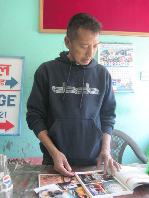 Nepali artist reads a book on US Sign Painters