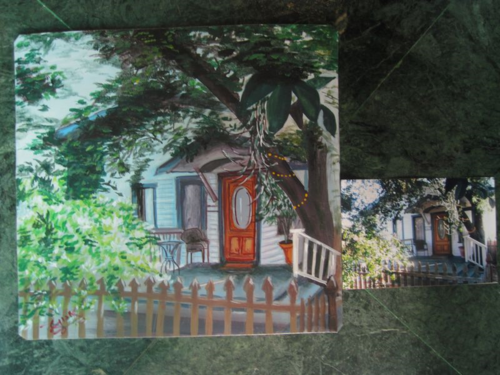 Folk art painting of a house hand painted on metal