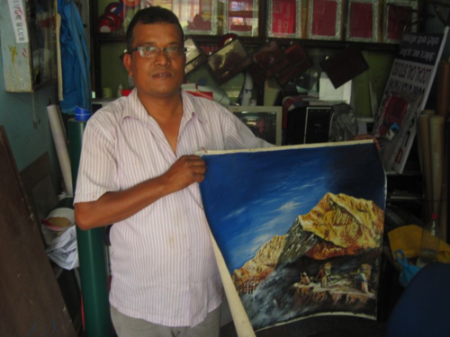 Kathmandu sign painter with his oil painting