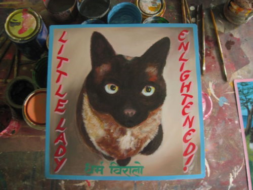 Folk art portrait of a Siamese cat hand painted on metal