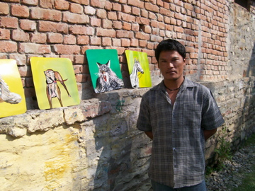 Nepali sign painter with his folk art