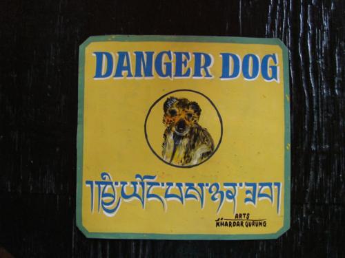 Tibetan Beware of Dog sign