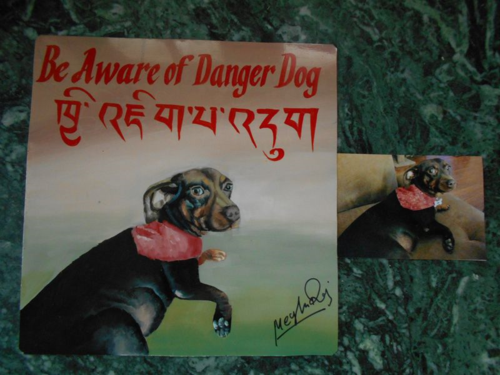 Folk art Dachshund hand painted on metal in Nepal