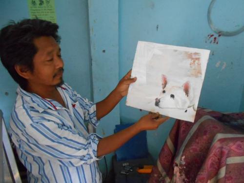 Folk art portrait of white shepherd hand painted on metal in Nepal