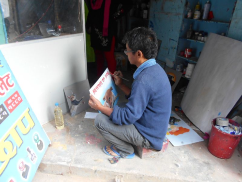 Sign painter at work in Nepal