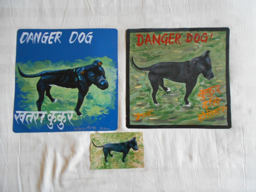 Folk art Black Labrador hand painted on metal by a sign painter in Nepal.
