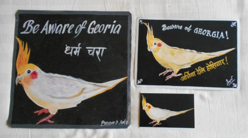 Folk art Cockatiel hand painted on metal in Nepal