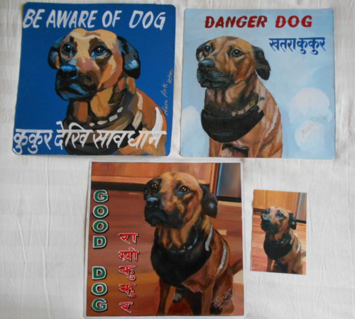 Folk art rescue dog hand painted on metal by a sign painter in Nepal