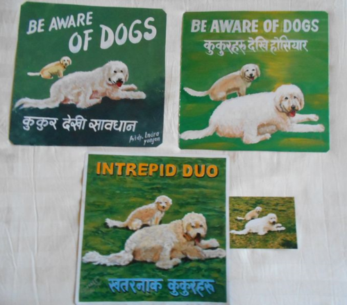 Folk art shaggy white dogs hand painted on metal in Nepal