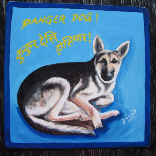 Folk art portrait of a German Shepherd hand painted on metal by Dilip