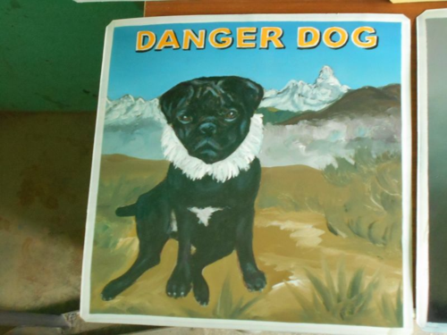 Folk art portrait of a Black Pug hand painted against the background of the Himalayas