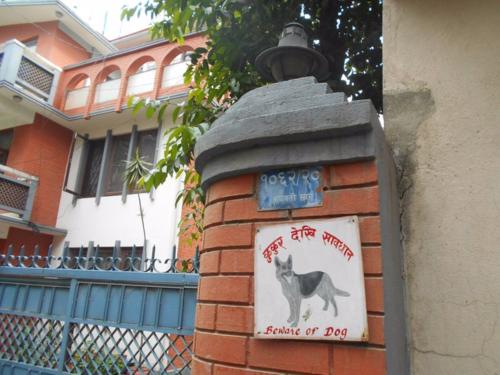 folk art beware of dog sign in Kathmandu