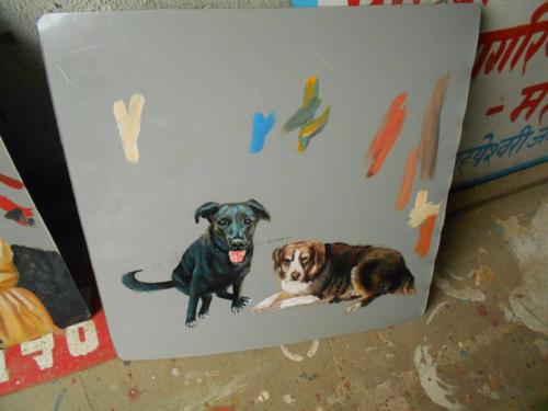 Folk art portrait of dogs hand painted on metal in Nepal by a signboard artist