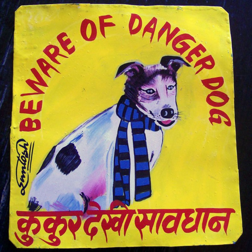 Folk art Beware of Jack Russell Terrier sign hand painted on metal in Nepal