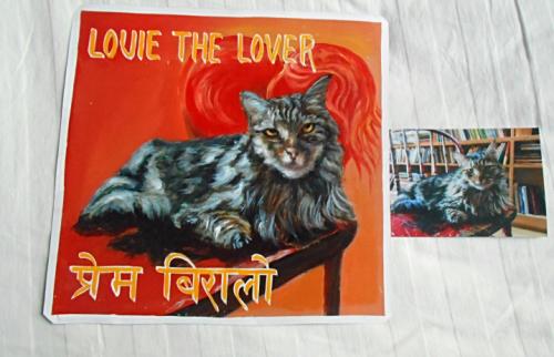 Folk art portrait of a cat hand painted on metal in Nepal