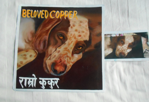 Folk art portrait of a Springer Spaniel mix hand painted on metal in Nepal