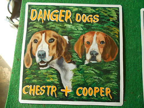 Folk art portrait of a Foxhound and a Beagle hand painted on metal in Nepal.