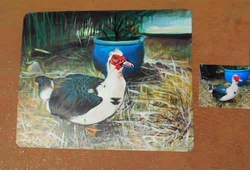Folk art portrait of a Muscovy Duck hand painted on metal in Nepal