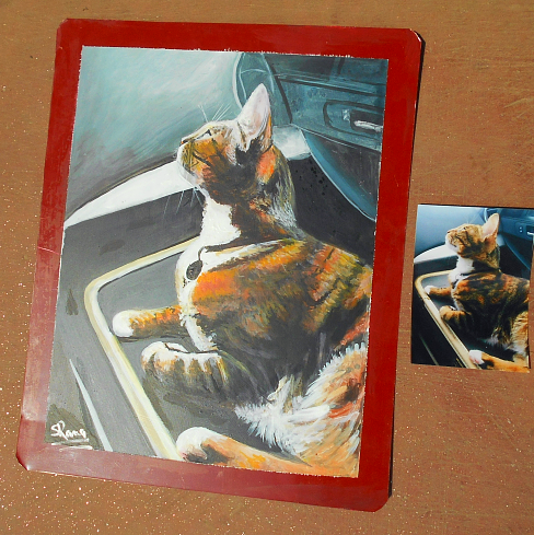 Folk art portrait of a Tabby Cat hand painted on metal in Nepl