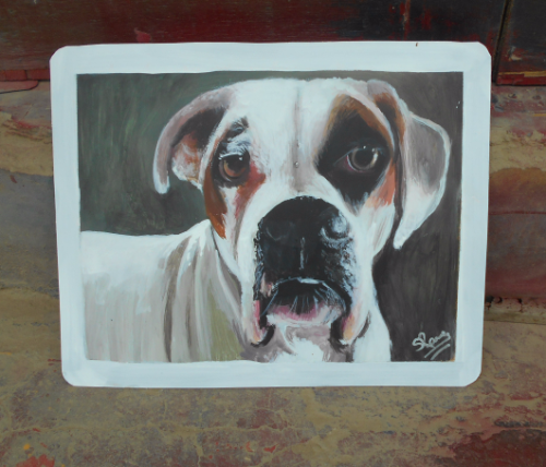 Folk art portrait of a Boxer dog hand painted on metal in Nepal