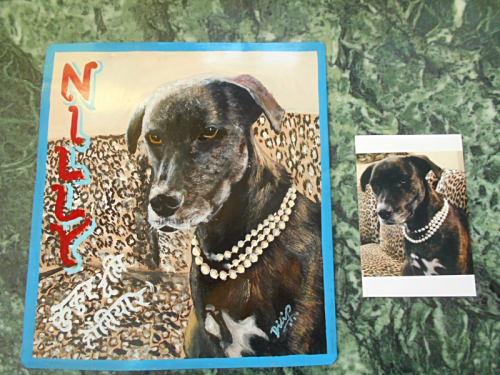 Folk art portrait of a rescue dog from Puerto Rico hand painted on metal in Nepal