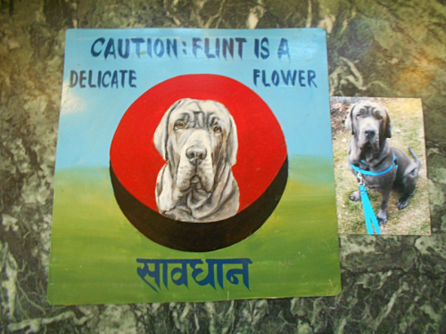 Folk art portrait of a Mastiff painted on metal in Nepal