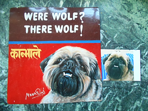 Folk art portrait of a dog hand painted on metal in Nepal
