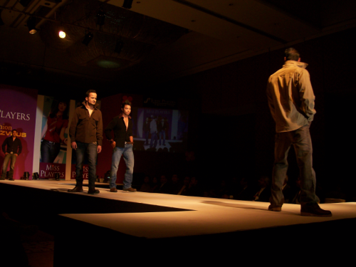 Male Nepali models wlk the runway
