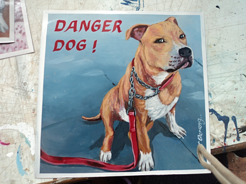 Folk art portrait of a Pit Bull Terrier hand painted on metal in Nepal