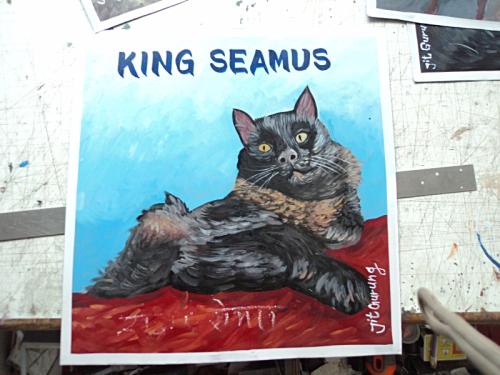 Folk art portrait of a Black Cat hand painted on metal