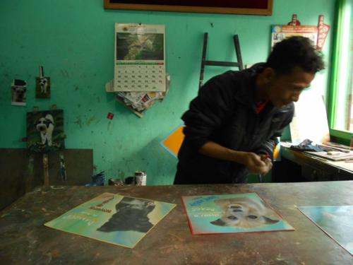 Artist signing his work in Kathmandu