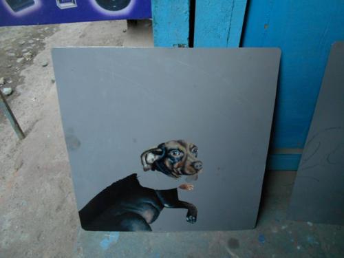 Folk art Dachshund hand painted on metal in Nepal