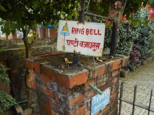 Folk art ring bell sign in Kathmandu