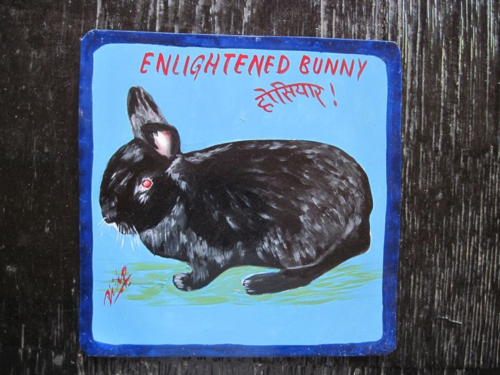 Folk art black rabbit hand painted on metal