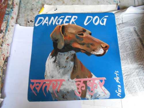 Folk art portrait of a German Shorthaired Pointer hand painted on metal in Nepal