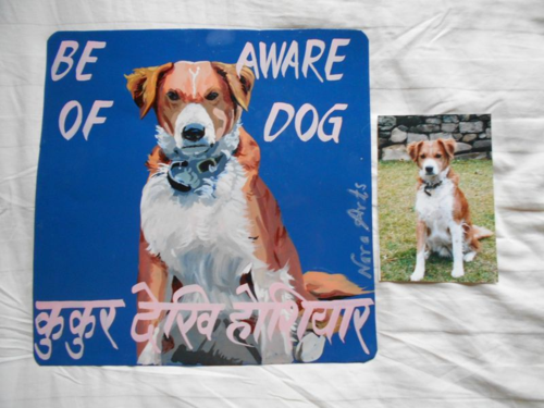 Folk art portrait of a Rascal Dog hand painted on metal in Nepal