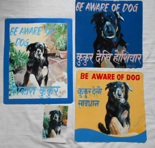 Folk art Beware of Dog sign hand painted on metal in Kathmandu