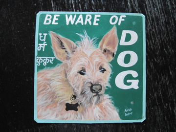 Folk art beware of Terrier Mix hand painted on metal by a signboard artist in Nepal