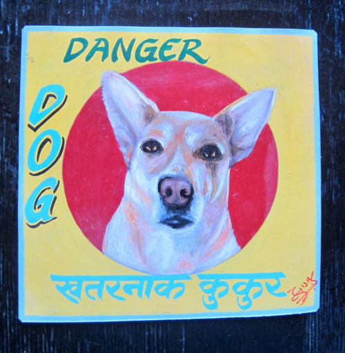 Folk art Beware of White Shepherd hand painted on metal by a signboard artist in Kathmandu, Nepal
