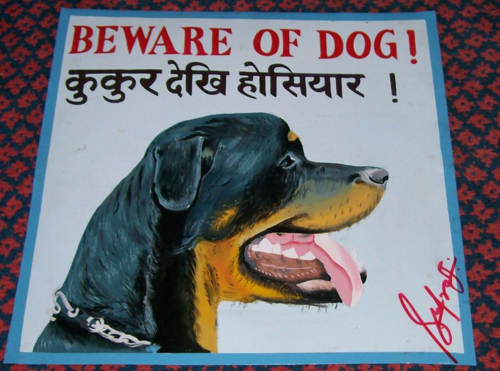 Folk art Beware of Rottweiler hand painted on metal in Kathmandu