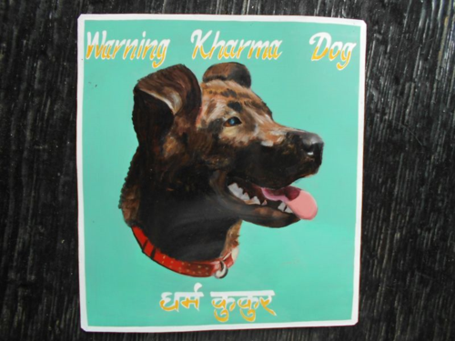 Folk art portrait of a Staffordshire Terrier hand painted on metal in Nepal
