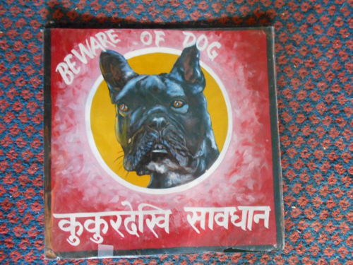 Folk art beware of French Bull Dog hand painted on metal in Nepal