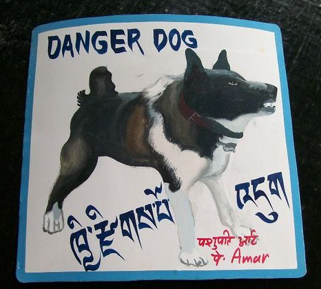 folk art Karelian Bear Dog hand painted on metal in Nepal