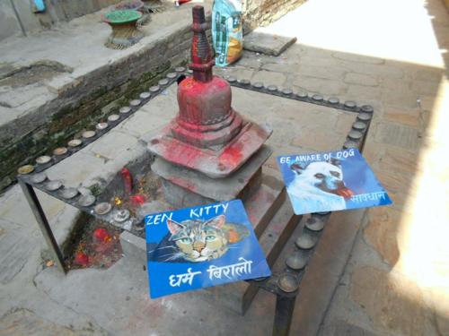 Folk art portraits of a dog and a cat on a temple in Kathmandu