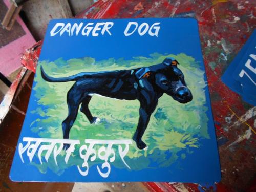 Folk art Black Lab Dog hand painted on metal by a sign painter in Kathmandu
