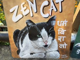 Folk art cat hand painted on metal in Nepal